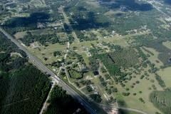Country Landings Subdivision located in this photo on the north east end of grass airstrip.