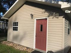 Separate Entrance door to two car garage for work shop or office